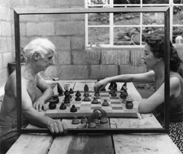 Max Ernst and Dorothea Tanning play chess in a picture frame. Photo: Bob Towers, Sedona, Arizona (1948).